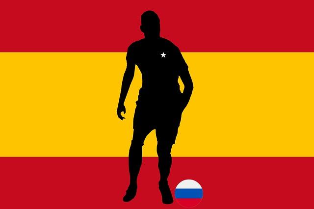Jugador de la selección española con la estrella y la bandera de Rusia